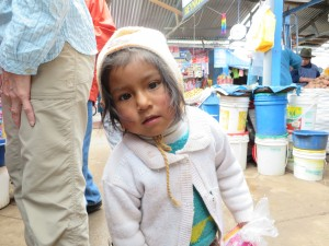 A child at an Andes market in Peru