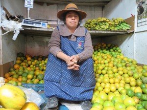 A fruit seller at an Andes market in Peru