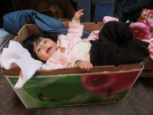 A little girl at the Andes Market in Peru