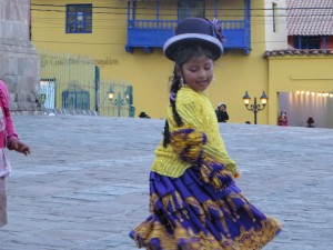 A young girl dancing at a carnival in Puno, Peru