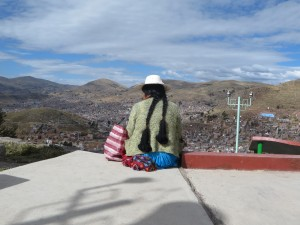 An old woman looking into town--Puno, Peru