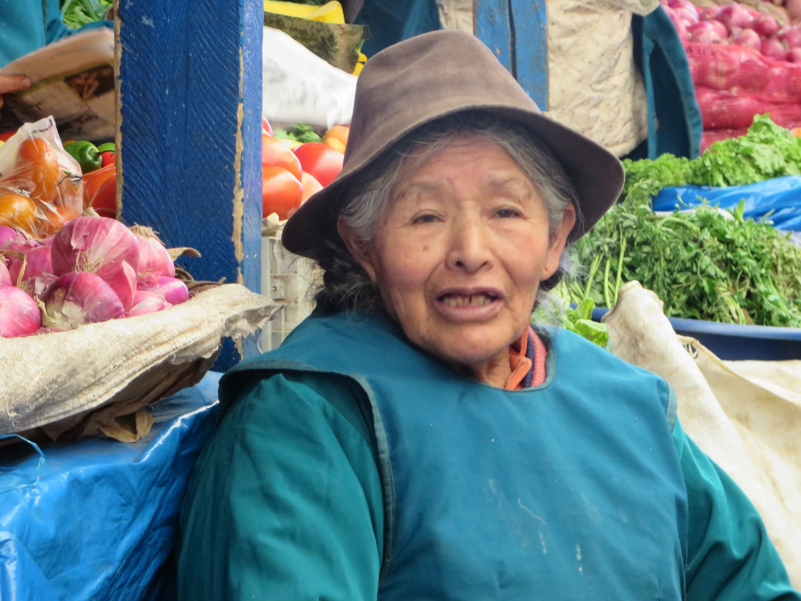Old seller at the Andes market in Peru