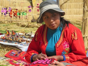 Young woman knitting on the Floating Islands of Uros on Lake Titikaka